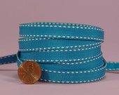 3/8 Side Stitch Ribbon - White on Turquoise