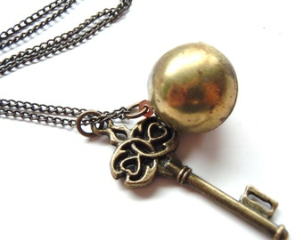 Ball Locket and Bronzed Filligree Key Charm Necklace on a Dark Chain Vintage Sphere Locket