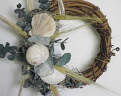 Grapevine wreath with sea glass,  seashells, coastal home decor and eucaluptus