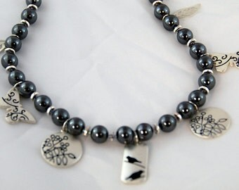 Black hematite necklace SALE  -  Nature Necklace with dangles - birds, leaves, butterfly. Matching earrings 1602a
