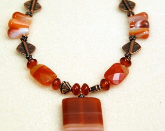 Red necklace 30% off - Red Orange quartz, striped red agate pendant, copper highlights. With earrings. Nature collection.