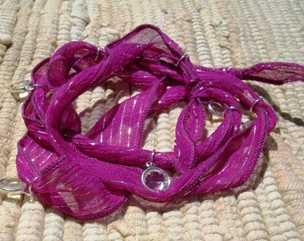 Seven Swarovski Crystal Charms Fuchsia Silk Wrap Bracelet-Sale was 40