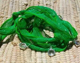 Seven Swarovski Crystal Charms Green Silk Wrap Bracelet Sale was 40