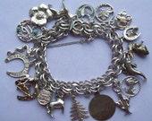 19 Charm Vintage Sterling Silver Bracelet