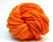 Super bulky orange handspun yarn in thick and thin merino wool - 70 yards, 4.4 ounces