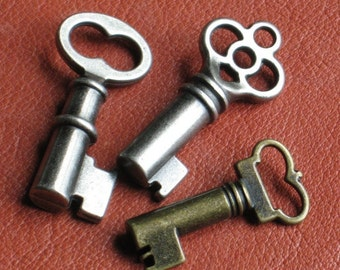 3 Skeleton Keys PLUS one FREE 18 inch ball chain Two-sided cast metal 2 Antique finishes Ox silver and brass ,NOT flat back stampings