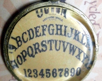 OUIJA board necklace pendant one inch round on antiqued brass 18 in chain  yellow board