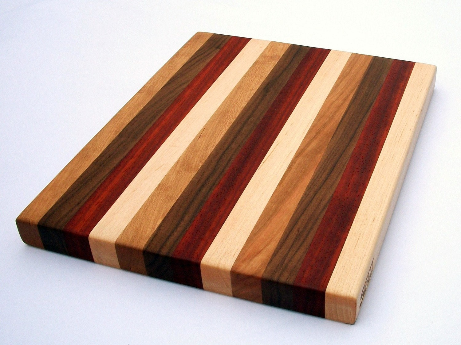 items similar to maple walnut padauk and cherry edge grain wood cutting board on etsy. Black Bedroom Furniture Sets. Home Design Ideas