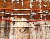 German Silk String and Tiny Bead Friendship Bracelet