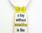 """Bamboo Tile Necklace, """"A day without sunshine is like night"""". Yellow & Black Beads."""