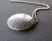 Domed silver pendant necklace