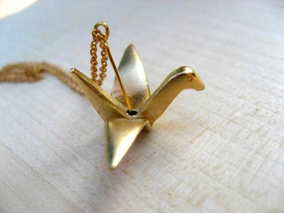 Serenity - A gold origami paper crane necklace