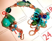 Asymetrical green bracelet FREE SHIPPING with beads copper wire wrapping