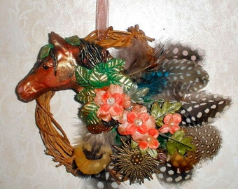 Horse wall art - polymer clay, feathers, and vintage jewelry on grapevine wreath