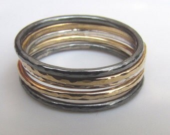 A Set of Five Silver and Gold Slim Stacking Rings