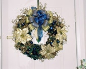 Gold poinsettias with blue ball ornaments