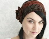 brown knitted headband with burnt orange crochet flower
