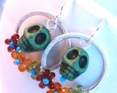 day of the dead (dia de los muertos) emerald  green magnesite sugar skulls with peridot, carnelian, turquoise and garnet flowers