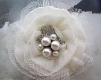 Ivory shiffon and netting bridal flower with pearls center