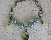 His Eye Is On The Sparrow Bracelet Soft Green Pearl Charm Antiqued Brass Bracelet