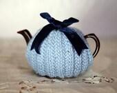Small brown teapot and blue alpaca tea cozy set