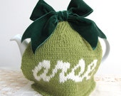"""Rude """"arse"""" green wool tea cosy"""