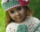 A set of 2pc hand crocheted doll poncho and matching hat
