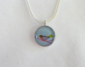 nnm-Round Bird Paper Charm on a Silver Plated Chain