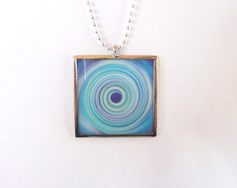 nnm-Retro Blue Swirl Square Charm on a Silver Plated Chain
