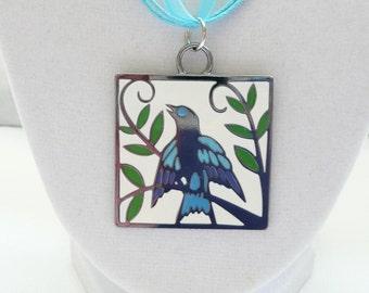 nnr-Blue Bird Pendant on a Blue Ribbon Necklace