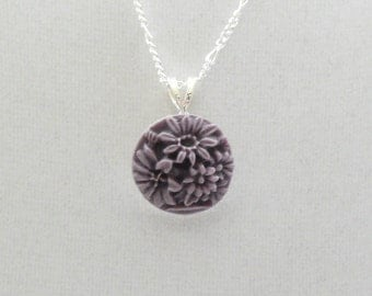 nnm-Purple Floral Cameo on a Silver Plated Chain