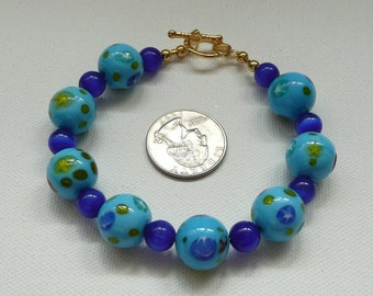 Blue Cats Eye and Blue Print Glass Bead Bracelet with Gold Toggle Clasp