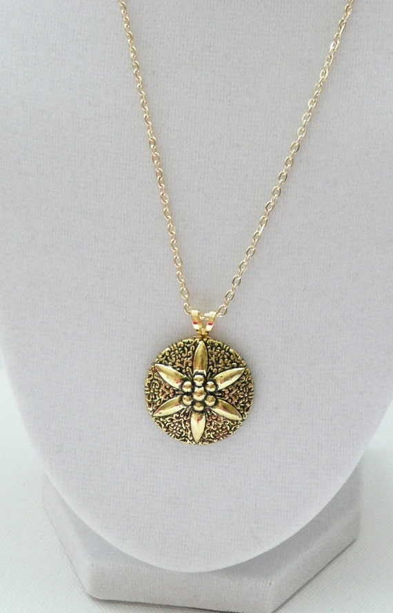Decorative Gold Pendant on a Gold Plated Chain