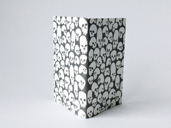 Under The Skin - pocket jotter -  white on black - recycled materials