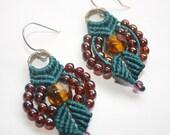 Teal colored macrame earrings with beadwork