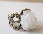 rose nouveau. ring (frosty white flower cabochon. antique brass ornate filigree. adjustable band.)