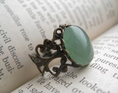 madame bovary ring. (green aventurine gemstone. antique brass ornate filigree. adjustable band.)