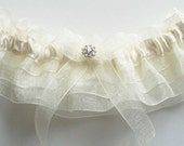 Wedding Garter and Toss Garter, Bride Garter in Ivory Organza Ruffles and Swarovski Crystal Centering - The MACKENZIE Garter