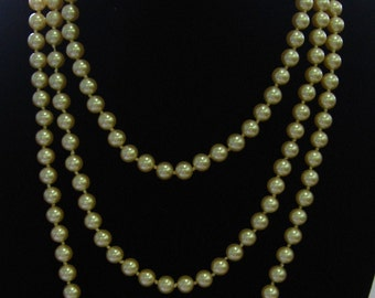 Miriam Haskell signed 60 inch stand of pearls