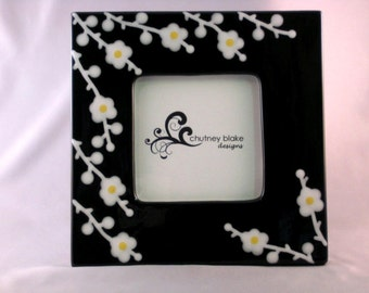 White Blossoms on Black Frame