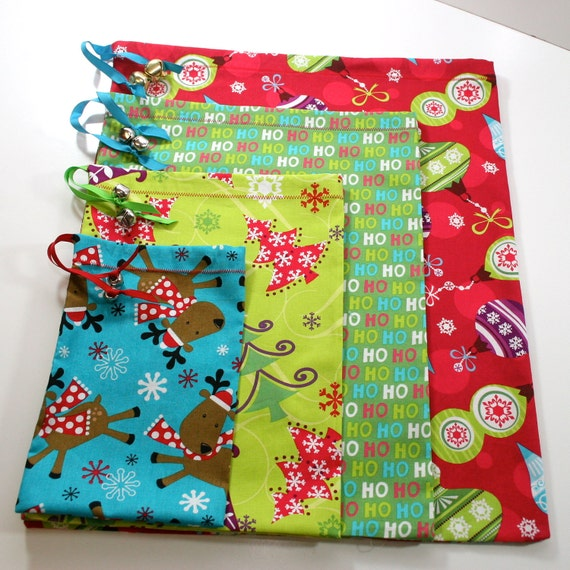 Christmas fabric gift bags set of four in by blueagavestudio