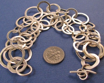 Hammered sterling silver three strand multi-size link chain bracelet