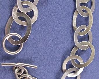 Hammered sterling silver oval/round link bracelet
