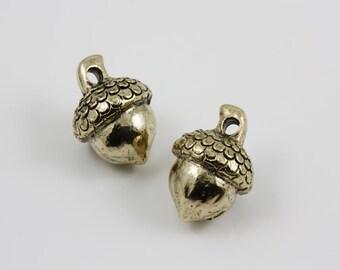 Antique gold Acorn charms (2)