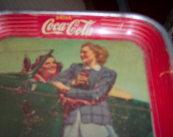 vintage coca cola tip tray from 1942  roadster