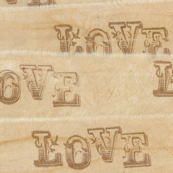 LOVE  vintage, worn hand made tea dyed muslin rubber stamped ribbon 1.5 . ... 7 . ....oohlala
