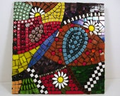 Spring garden glass and ceramic mosaic in bright rainbow colors with black and white accents, 12x12, framed