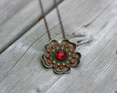 F L O R A jewel encrusted flower pendant on antiqued brass chain