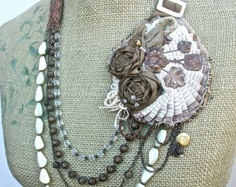 Tumbleweed- tie necklace/ earring set with shabby fabric assembled feature, Vintage bronze stampings, Vintage MOP beads and seed pearls
