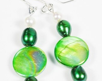 These lovely earrings are made with green freshwater pearls and mother of pearl geads and silver wires